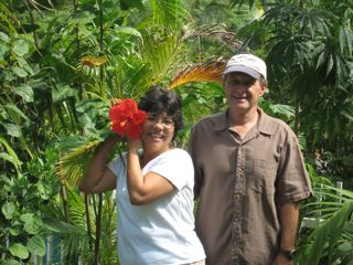 marlina& richard checking out our giant hybiscus plants