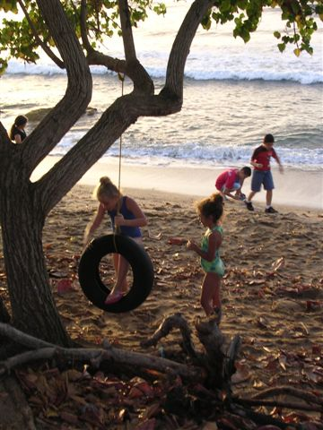 swinging around on an old tire at rincons beach